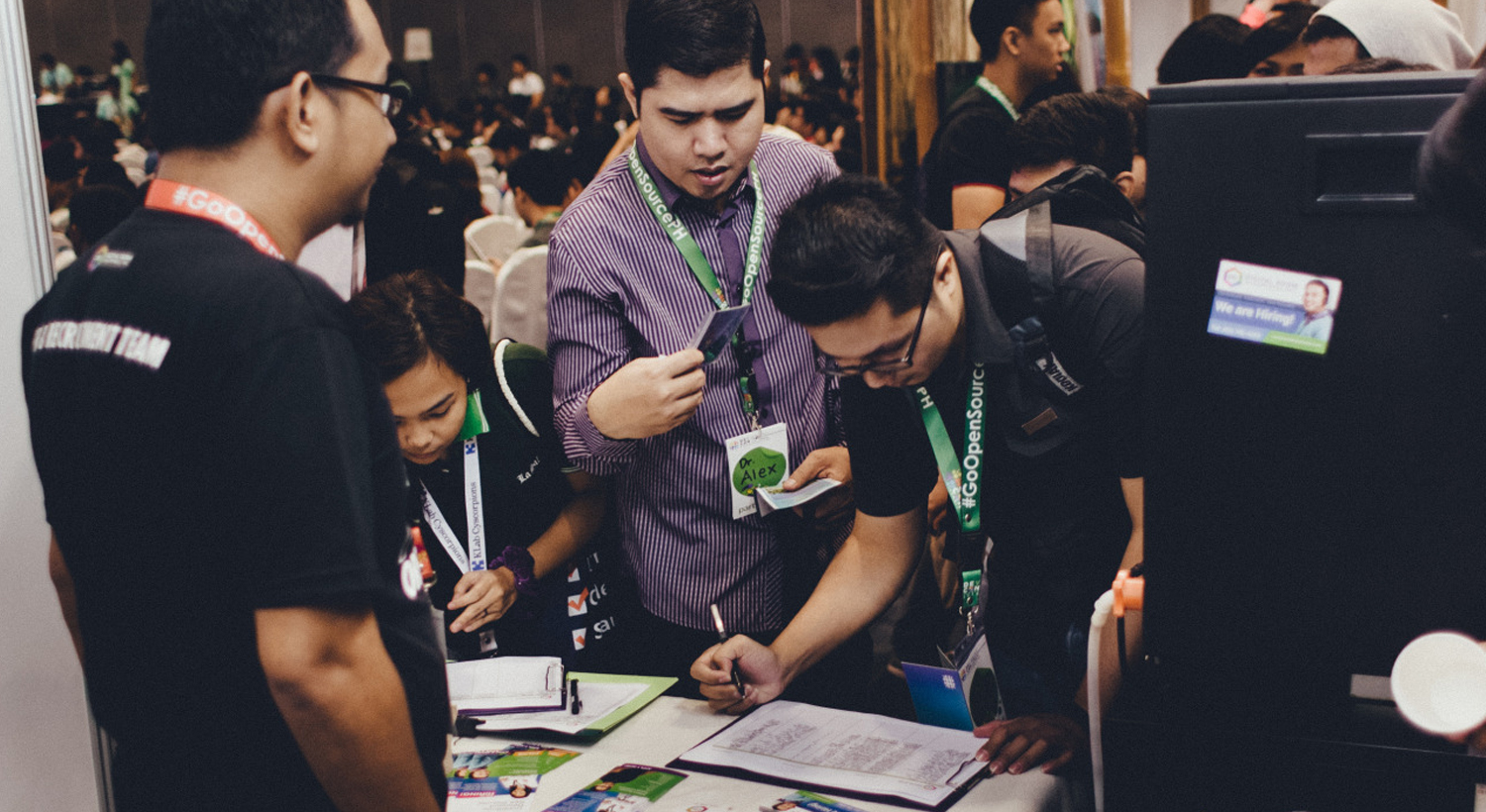People signing up for an email list during a trade show