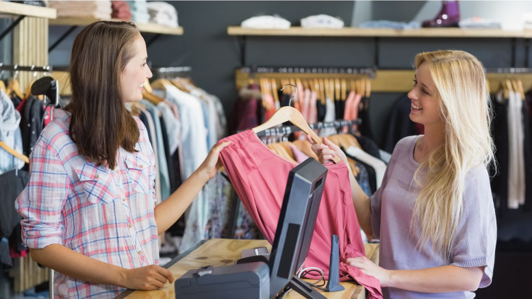 Employee giving clothing recommendations to customer