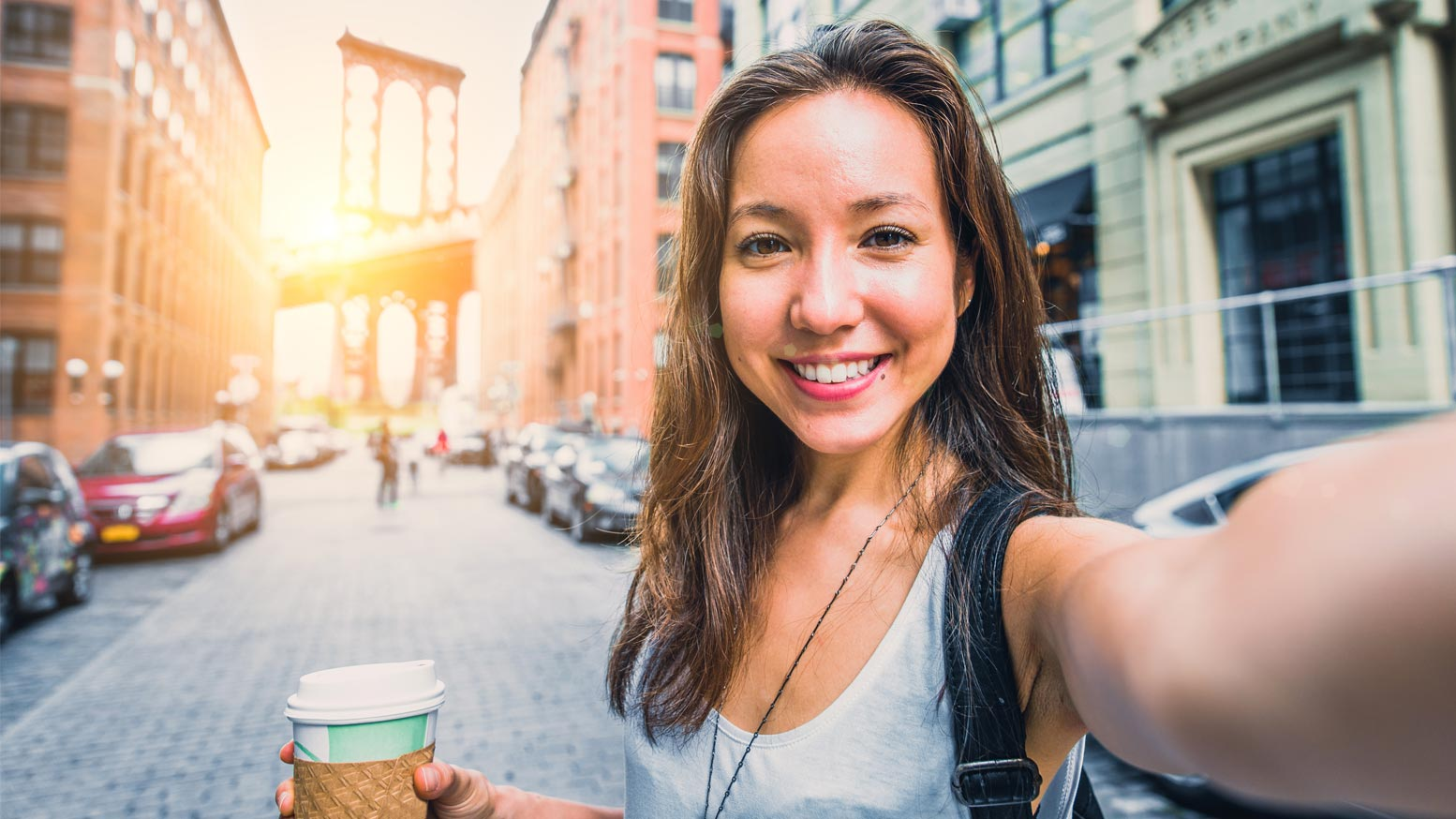 Woman having a selfie with a coffee cup