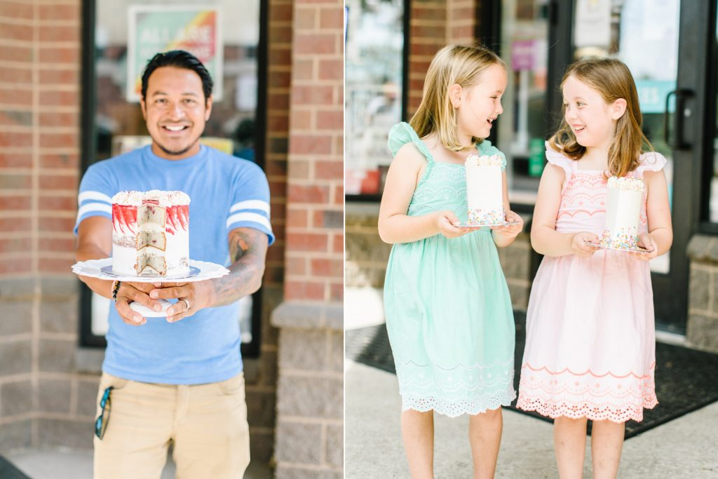 Amy's Cupcake Shoppe customers holding cake