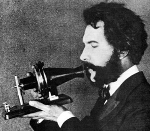 Alexander Graham Bell with the first telephone