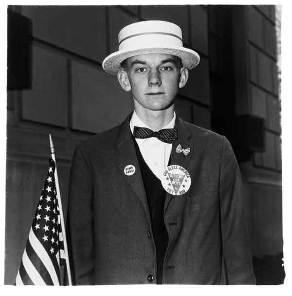 Diane Arbus - Boy With a Straw Hat Waiting to March in a Pro-War Parade, N.Y.C. 1967 via YouTheDesigner.com