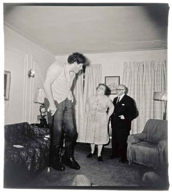Diane Arbus - Jewish Giant, taken at Home with His Parents in the Bronx, New York, 1970 via YouTheDesigner.com