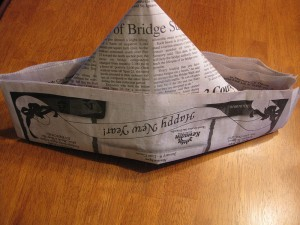 Newspaper hat by  Kate Ter Haar